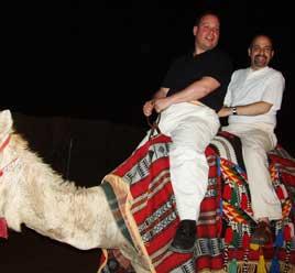 David Krane and Stephen Cole riding a camel